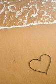 Heart simbol on the sand — Foto de Stock