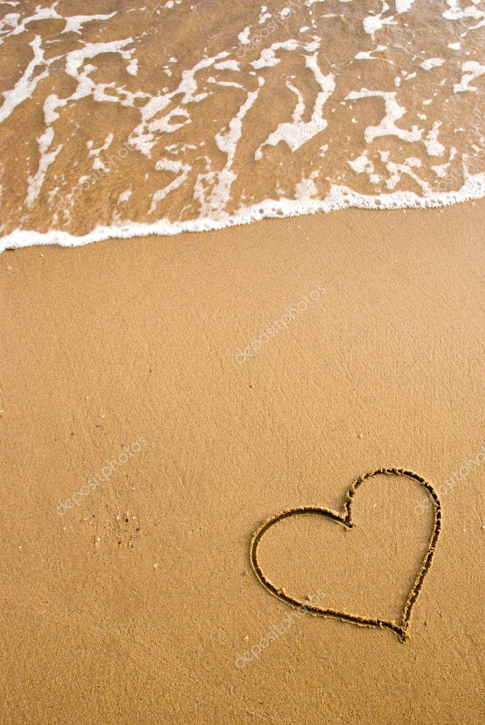 Heart simbol on the sand — Stock Photo #2406078