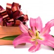 Pink lily and gift box on a white — Stock Photo #2419475