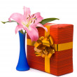 Pink lily and gift box on a white — Stock Photo #2447834