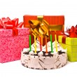 Pie with six candles and gifts — Stock Photo