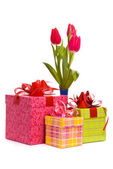 Red tulips in blue vase — Stock Photo