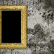 Old grunge wall with vintage gold frame — Stock Photo #2482093