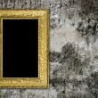 Stock Photo: Old grunge wall with vintage gold frame