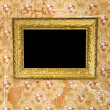 Old grunge wall with vintage gold frame — Stockfoto