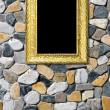 Golden frame on stone background — Stock Photo
