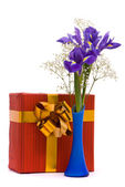 Bouquet of a irises and gift box — Stock Photo