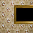 Vintage frame on wallpaper background — Stock Photo