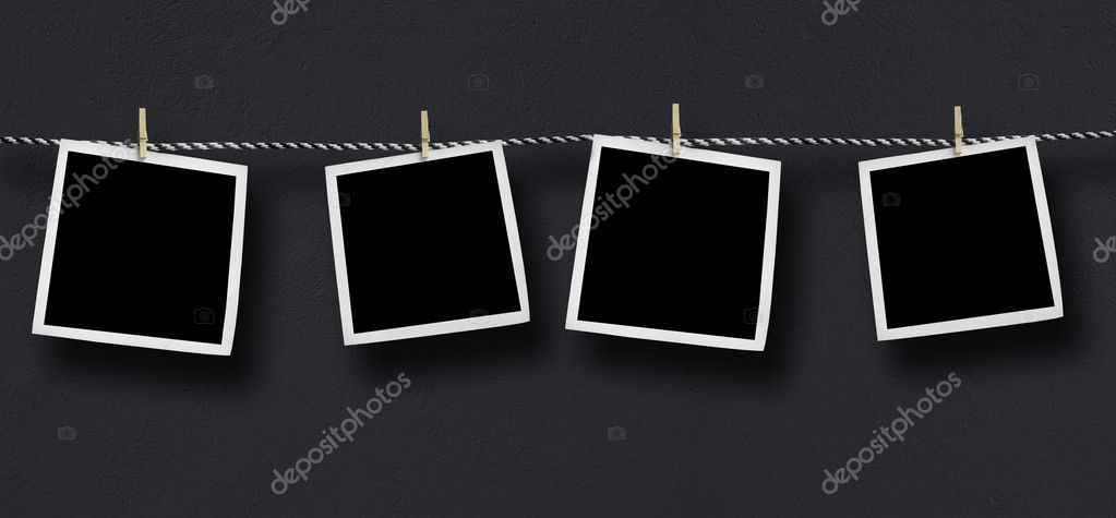 Blank photos hanging on a clothesline  Stock Photo #2644104