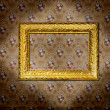 Golden frame over old grunge wallpaper — Stock Photo