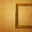 Vintage frame over golden wallpaper — Stock Photo #2677575