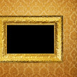 Vintage frame over golden wallpaper — Stock Photo #2677680