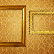 Vintage frame over golden wallpaper — Stock Photo