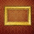 Vintage frame over red wallpaper — Stock Photo
