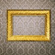 Gold frame over vintage wallpaper — Stock Photo #2678425