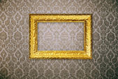 Gold frame over vintage wallpaper — Stock Photo