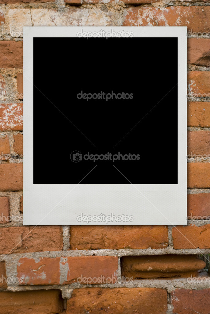 Blank photo card on old bricks wall — Stock Photo #2675725