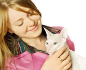 Young woman with a cat — Stock Photo