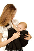 Breast-feeding in sling — Stock Photo