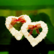 Stock Photo: Two hearts on green glass