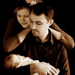 Parents with newborn baby in sepia — Stock Photo