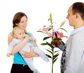 Women with baby accepts a compliment — Stock Photo