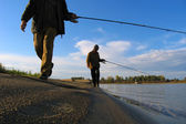 2 Fisherman fishes on a shallow — Stock Photo