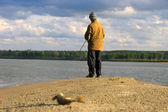 Fisherman fishes on a shallow — Stock Photo