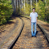 The young man costs on rails — Stock Photo