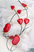 Accessory with red hearts and stones — Stock Photo