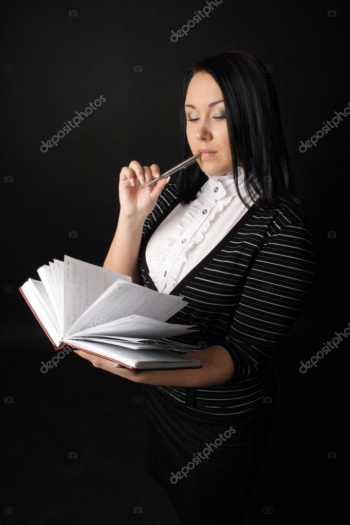 The girl with the daily log on a black background — Stock Photo #2501647
