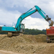 Excavator and lorry — Stockfoto