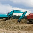Stock Photo: Excavator and lorry