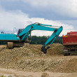 Stockfoto: Excavator and lorry