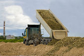 Truck unloading gravel — Stock Photo