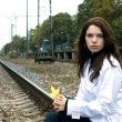 Beautiful woman waiting for the train on — Stock Photo