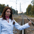 Stock Photo: Beautiful woman trying to hitch train