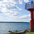 Old red lighthouse in Estonia - Stock Photo