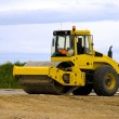 Yellow road roller at work — Stock Photo