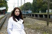 Beautiful woman on railway tracks — Stock Photo