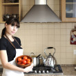 Young housewife in kitchen — Stock Photo #2669433
