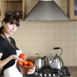 Beautiful housewife cooking — Stock Photo