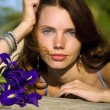 Portrait of pretty woman with flowers — Stock Photo