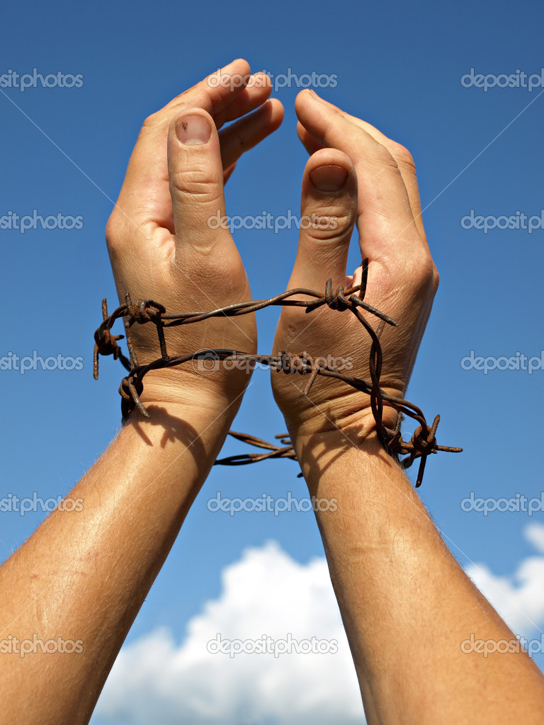 Raised hands of slave to the blue sky       — Stock Photo #1370780
