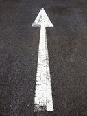 Arrow on the road — Stock Photo