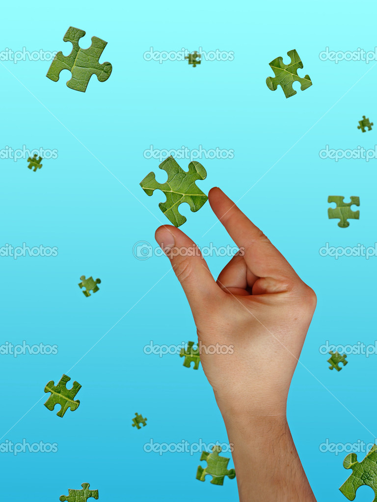 concept for environment problems solving. hand catching puzzle pieces — Stock Photo #1516571