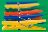 Row of colorful clothes pegs — Stock Photo