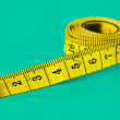Yellow measuring tape — Stock Photo