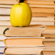 Apple on stack of books — Stock Photo
