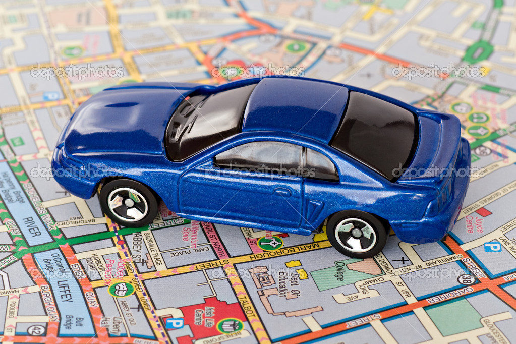 Tourism concept. small  blue car on Dublin city map — ストック写真 #2469379